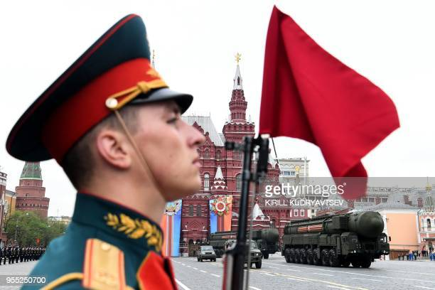A Russian Yars RS24 intercontinental ballistic missile system parades through Red Square during the general rehearsal of the Victory Day military...