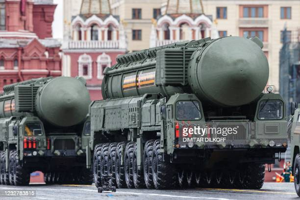 Russian Yars RS-24 intercontinental ballistic missile systems move through Red Square during the Victory Day military parade in Moscow on May 9,...