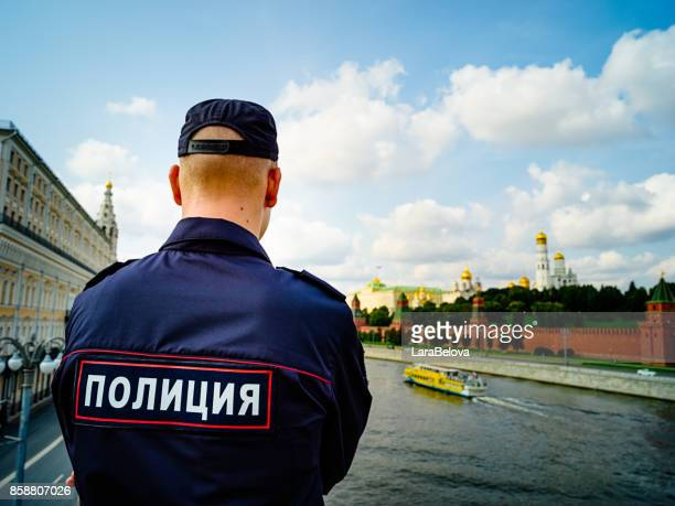 russian young policeman looking at kremlin from the bridge - russia stock pictures, royalty-free photos & images