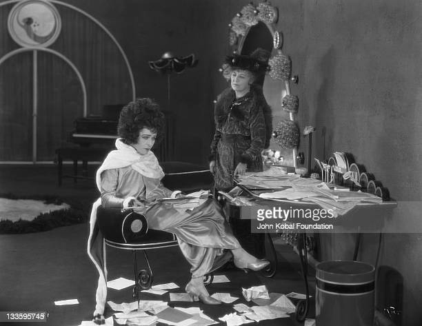 RussianAmerican actress Alla Nazimova as Marguerite Gautier and Zeffie Tilbury as Prudence in a scene from 'Camille' directed by Ray C Smallwood 1921...