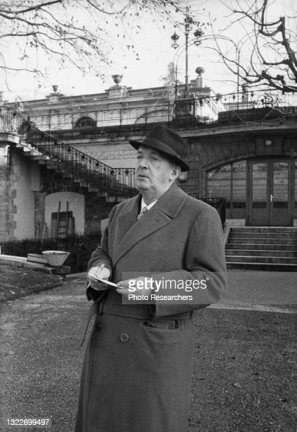 Russian-American author Vladimir Nabokov , with paper and pencil in his hands, as he stands outside the Montreux Palace Hotel, Montreux, Switzerland,...