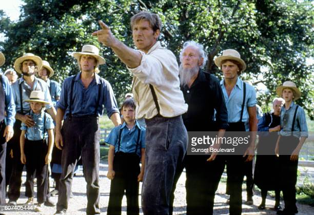 RussianAmerican ballet dancer and actor Alexander Godunov American actors Lukas Haas Harrison Ford and DanishAmerican Viggo Mortensen on the set of...