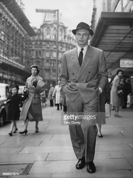 Russianborn actor Yul Brynner strolls through Leicester Square in London 16th March 1959 He is in the capital for the UK premiere of his film 'The...