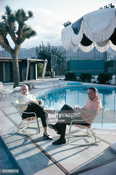 Russian-born actor Yul Brynner with American singer and actor Frank Sinatra at his Palm Springs home at the Tamarisk Country Club.