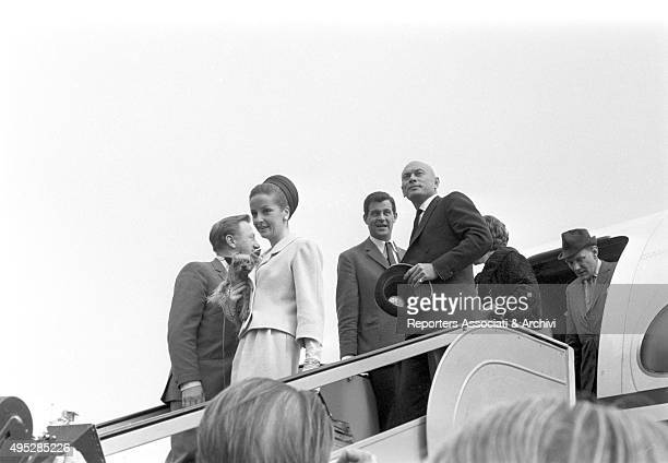 Russianborn American actor Yul Brinner walking down the aircraft ladder at the airport with his wife Doris Kleiner for a film festival Vienna 1968