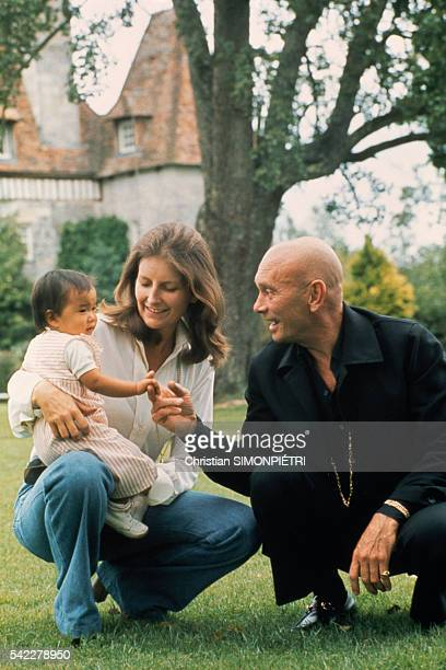 Russian-born American actor Yul Brynner with his third wife, Jacqueline de Croisset and his recently adopted Vietnamese daughter Mia, 10 months, at...