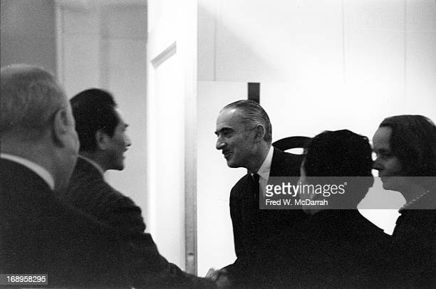 Russianborn American artist and editor Alexander Liberman greets unidentified guests at an exhibit of his work New York New York April 4 1960