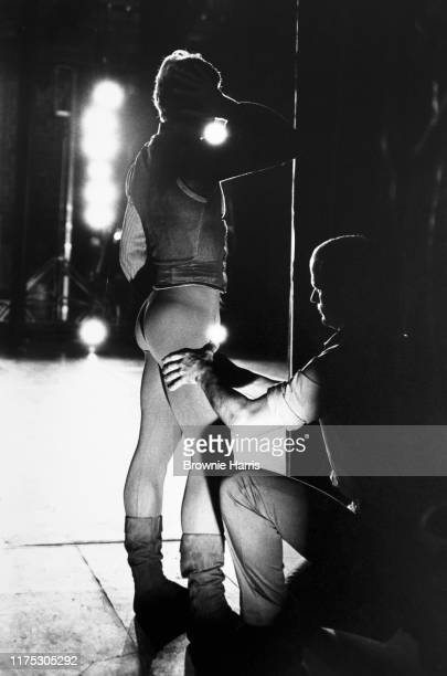 Russian-born American ballet dancer Mikhail Baryshnikov with a massage therapist during the American Ballet Theatre's production of 'Other Dances' at...
