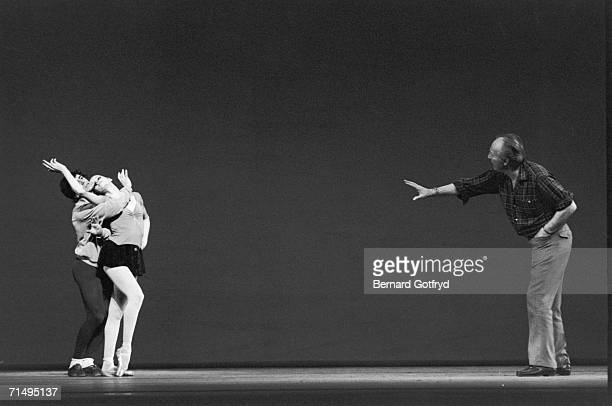Russianborn American ballet director and choreographer George Balanchine directs a pair of dancers during an onstage rehearsal New York New York June...