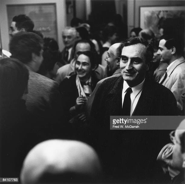 Russianborn American painter Milton Resnick smiles as he stands among others at an unidentified event New York New York 1950s or early 1960s