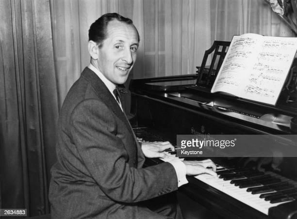 Russian-born American pianist Vladimir Horowitz playing the piano at Claridge's Hotel in London, 21st September 1951.