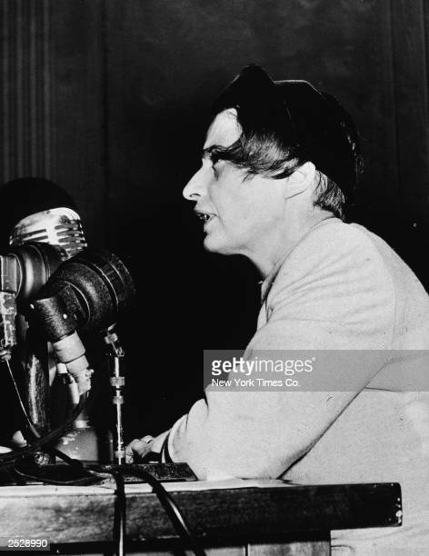 Russianborn author and philosopher Ayn Rand speaks at microphones discussing the film 'Song of Russia' New York City October 1947