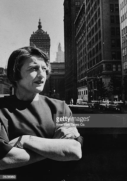 Russianborn author and philosopher Ayn Rand stands with her arms folded on a street in New York City 1957