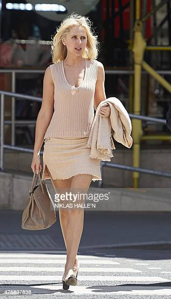 Russianborn Ekaterina Fields arrives at the High Court for a decision on her divorce settlement with estranged husband US lawyer Richard Fields in...