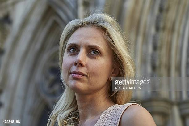 Russianborn Ekaterina Fields leaves the High Court after a decision on her divorce settlement with estranged husband US lawyer Richard Fields in...