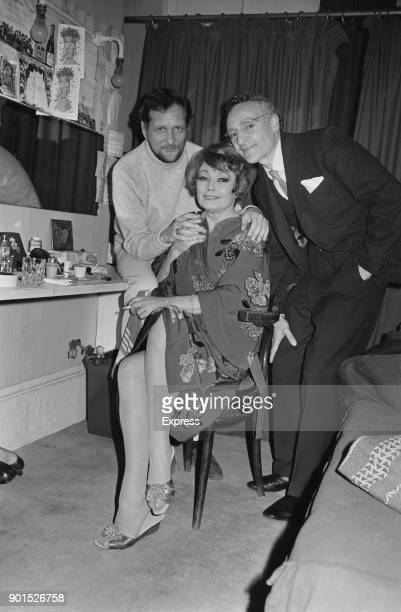 Russianborn French actress Lila Kedrova American poet Richard Howard and British actor Barry Martin in a changing room West End Londdon UK 25th June...