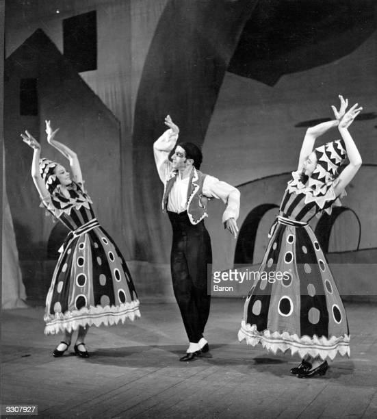 Russianborn US choreographerdancer Leonide Massine dancing in a production of 'Three Cornered Hat' with English ballet dancer Margot Fonteyn at...