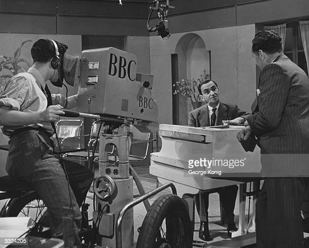 Russianborn US composer Irving Berlin being interviewed at Alexandra Palace north London by Wynford Vaughan Thomas for a BBC television programme