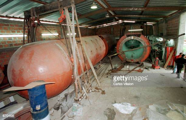 Russiandesigned submarine that was being built by drug dealers sits in a small factory September 18 2000 in Faca Tativa Colombia after being seized...