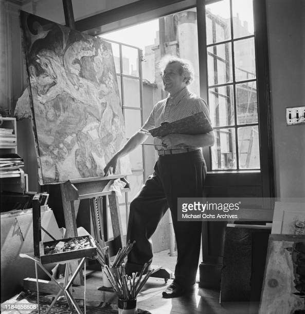 Russian-French artist Marc Chagall at work on a circus painting in his studio, circa 1942.