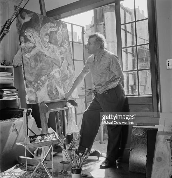 Russian-French artist Marc Chagall at work on one of his circus paintings, circa 1942.