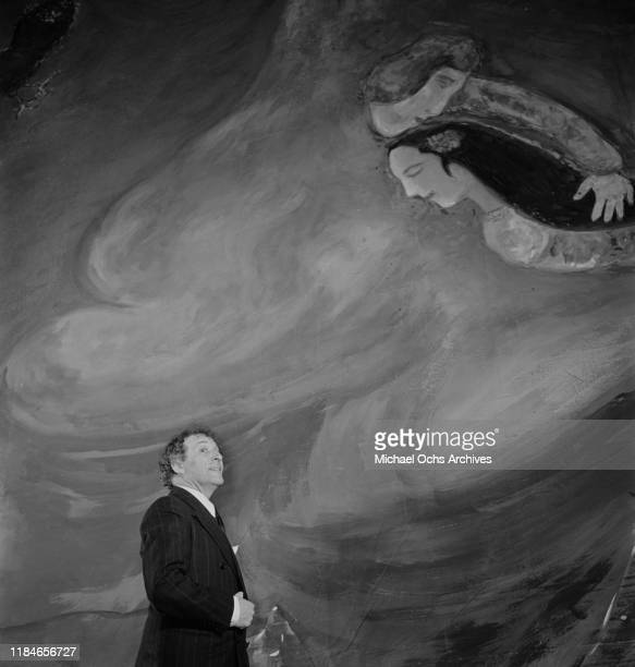 Russian-French artist Marc Chagall with one of his paintings, circa 1942.