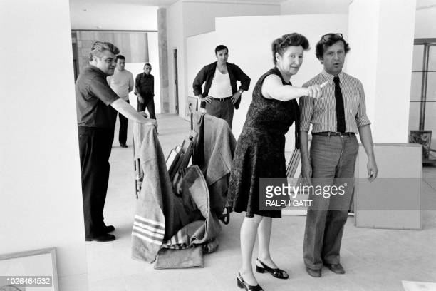 RussianFrench artist Marc Chagall's daughter Ida Chagall Meyer prepares the hanging of the collection of her father on June 25 1973 for the opening...