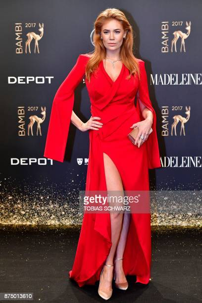 RussianGerman TV host Palina Rojinski poses on the red carpet upon her arrival for the 2017 BAMBI awards ceremony on November 16 2017 at the Stage...