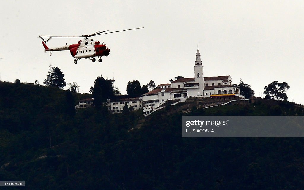 A Russian-made MI-17 helicopter used in operation 'Jaque' (Check) to liberate French hostage Ingrid Betancourt, among others, from their FARC captors flies in front of Monserrat mount during Independence Day celebrations in Bogota, on July 20, 2012. AFP PHOTO/Luis Acosta /