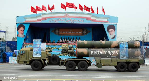 A Russianmade S300 missile system drives in front of the officials' stand during a military parade marking the annual Iranian National Army Day in...