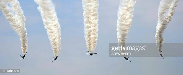 Russianmade Sukhoi jet fighters from the Indonesian Air Force execute a flyby during a ceremony marking the 66th Indonesian Independence Day in...