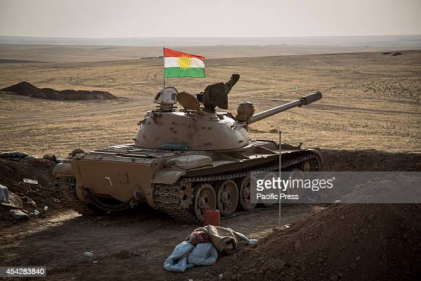 Russianmade T55 tank is positioned facing toward ISIS lines a few kilometers away Khazir refugee camp is located outside Kalak a town halfway on the...
