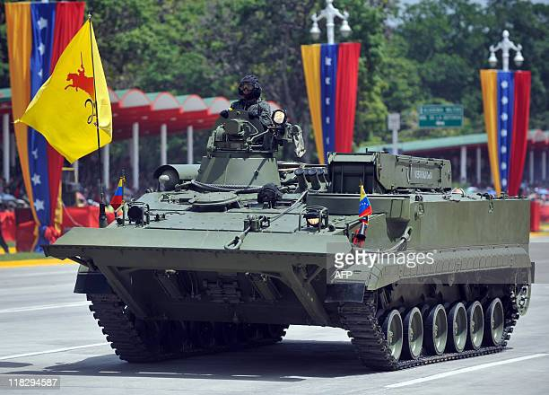 A Russianmade Venezuelan engineers' armored vehicle parades during the commemoration of Venezuela's Bicentennial in Caracas on July 5 2011 Venezuela...