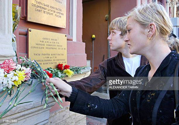 Russians lay flowers outside the US consulate in StPetersburg 11 September 2006 to mark the fifth anniversary of the 11 September 2001 attacks in New...