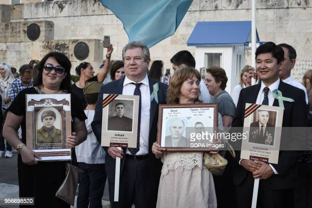 Russians living in Greece seen holding old photographs during The Immortal Regiment march Thousands of Russian citizens participated in the...