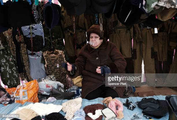 Russians many of them poor sell items at an outdoor flea market on the outskirts of Moscow on March 5 2017 in Moscow Russia Relations between the...