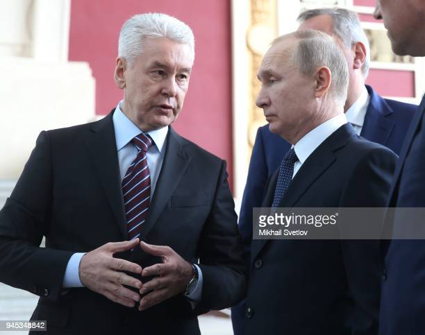 Russians President Vladimir Putin and Moscow' Mayor Sergey Sobyanin observe the exposition at the Cosmos pavillion space industry exhibiton on April...