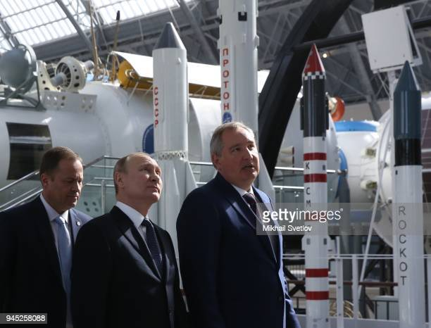 Russians President Vladimir Putin Deputy Prime Minister Dmitry Rogozin and Roscosmos Head Igor Komarov observe the exposition of missiles at the...