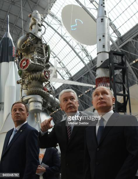 Russians President Vladimir Putin Moscow's Mayor Sergei Sobyanin and Roscosmos Head Igor Komarov observe the exposition of missiles at the Cosmos...