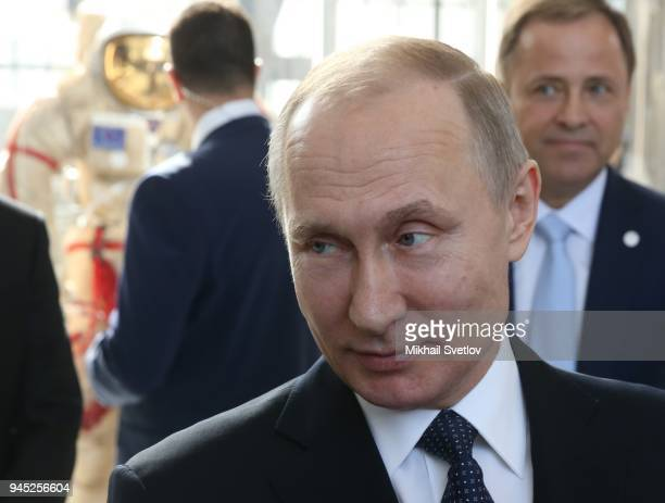 Russians President Vladimir Putin observes the exposition of missiles at the Cosmos pavillion space industry exhibiton on April 12 2018 in Moscow...