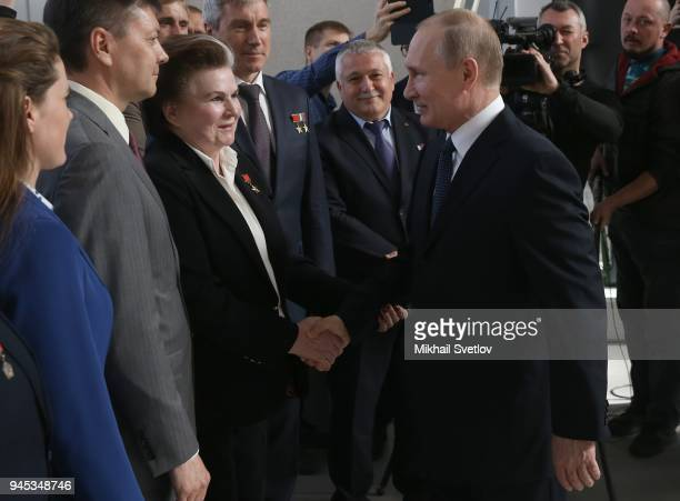Russians President Vladimir Putin shakes hands with the first female cosmonaut in the World Valentina Tereshkova while visiting the exposition of...