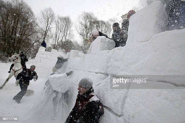Russians storm a snowfort while celebrating the 'Maslenitsa' holiday in the Siberian city of Novosibirsk on February 14 2010 The 'Maslenitsa' also...