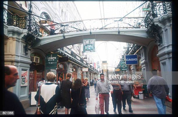 Russians visit the Gum Department Store July 25 1997 in Moscow Russia The only city in Russia with a rapidly growing middle class Moscow has been...