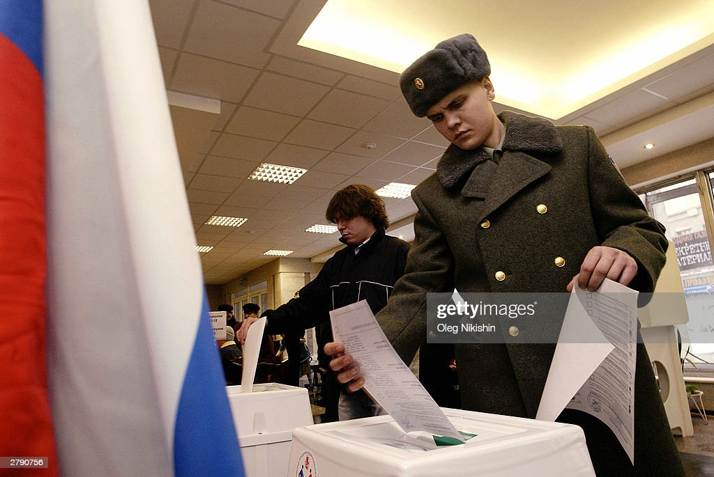 Russians vote in a polling station December 7, 2003 in Moscow. Russian voters went to the polls to elect a new parliament in a ballot that could give President Vladimir Putin's United Russia party a majority against the liberal opposition.