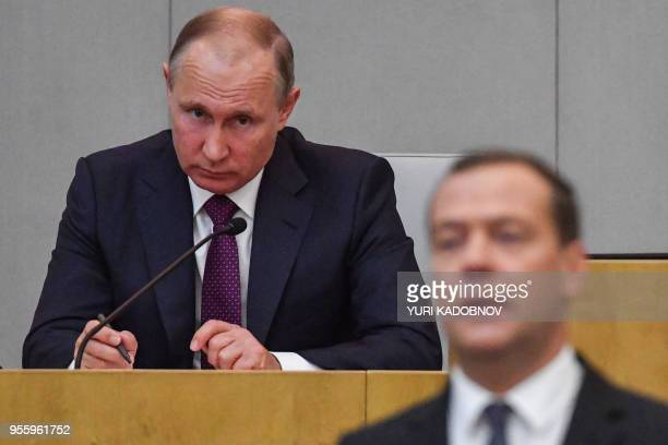 TOPSHOT Russia's acting Prime Minister Dmitry Medvedev and President Vladimir Putin attend a session of the State Duma in Moscow on May 8 2018...