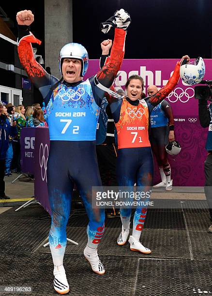 Russia's Albert Demchenko and Tatyana Ivanova celebrate in the Luge Team Relay at the Sliding Center Sanki during the Sochi Winter Olympics on...