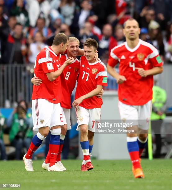 Russia's Aleksandr Golovin celebrates scoring his side's fifth goal of the game with his teammates during the FIFA World Cup 2018 Group A match at...