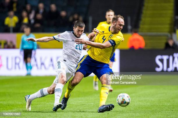 Russia's Aleksei Ionov battles with Sweden's Andreas Granqvist during the UEFA Nations League B group two match between Sweden and Russia at Friends...
