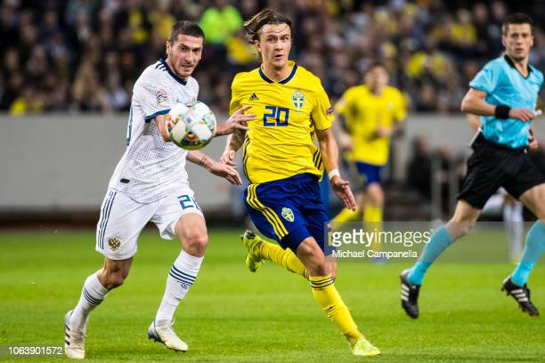 Russia's Aleksei Ionov battles with Sweden's Kristoffer Olsson during the UEFA Nations League B group two match between Sweden and Russia at Friends...