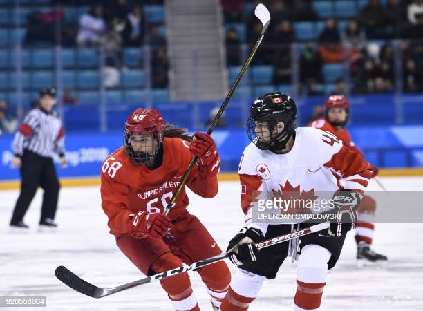 Russia's Alevtina Shtaryova vies with Canada's Blayre Turnbull in the women's semifinal ice hockey match between Canada and the Olympic Athletes from...